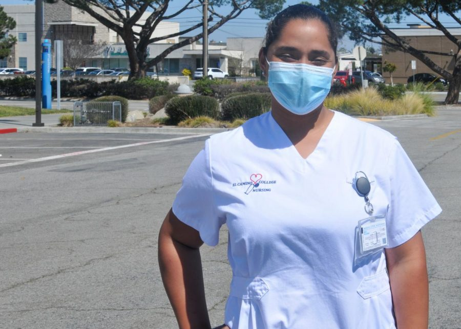Lidia Tejeda, a 30-year-old El Camino College nursing major, poses for a picture right after leaving her in-person nursing class on March 18, 2021, in Torrance, Calif. Tejeda is one of the few ECC students that have been able to take classes on campus during the Covid-19 pandemic. Tejeda said that she