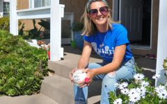 "Erica Brenes, associate English professor at El Camino College, sits next to a bed of freshly bloomed daisies on her front porch in Long Beach on March 24. Brenes feels that poetry is a great vehicle to help her students connect with the humanities. ""Poetry asks you to have a heightened awareness about the way you choose to spread and share your message,"" Brenes said. (Walter Jay Jr. / The Union)"
