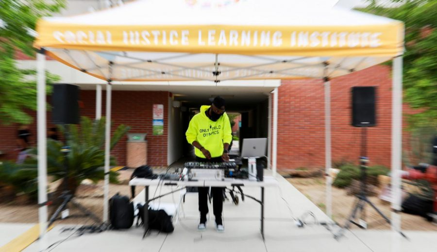 George Twopointon livens up the Wondalunch event on Saturday April  24,at El Camino Colleges parking lot B with his DJ performance, providing musical entertainment throughout the event. (Mari Inagaki/ The Union)