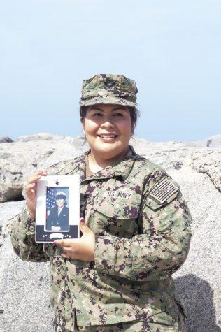 Lesley Mercado at Vista Del Mar, El Segundo Beach April 10, 2021 holding Bootcamp Graduation photo. (Patricia Carrillo/ Warrior Life)