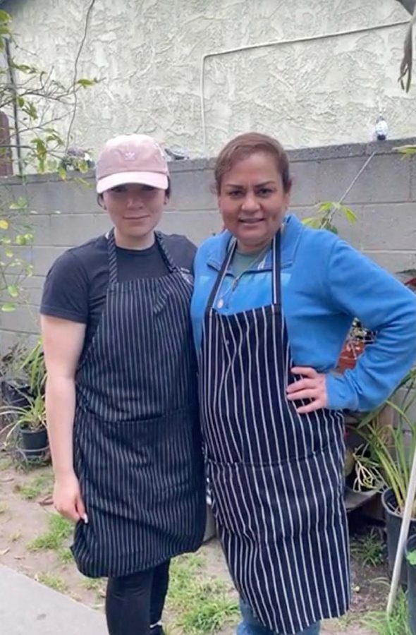 Lourdes Vazquez Mejia (left) and her mother, Sandra Vazquez (right) pose for a photo between prepping meals for customers at Birreria3rageneracion, the restaurant they run out of their home backyard in Harbor City, on May 2. Photo credit: Jesus
