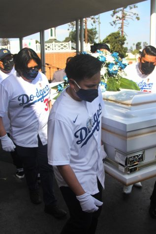 Juan Miranda's coffin and body are carried to the hearse by his father, brothers and family members acting as pall-bearers to be driven off to their final resting place on Friday, April 9 in Inglewood Park Cemetary. (Jaime Solis/ The Union)