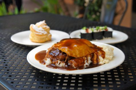 (From left to right): Chocolate Cream Puff ($1.50), Loco Moco ($10) and Portuguese Sausage Musubi ($3) at Back Home in Lahaina in Carson, Calif. on May 8, 2021. The Cream Puff is an airy pastry filled with chocolate filling and whipped cream. The loco moco is two never frozen, house-ground third-pound hamburger patties with two eggs over-easy, a side of macaroni salad, on a bed of freshly steamed rice, all covered in a velvety demi-glace. And the Portuguese Sausage Musubi is three pieces of spicy Portuguese-link sausage sushi. (Walter Jay Jr. / Warrior Life)