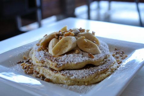 """The """"Best Ever"""" Banana Pancakes ($10) at The Pan in Gardena, Calif. on May 8, 2021. Three buttermilk pancakes filled with a banana-cinnamon puree and topped with bananas, walnuts, whipped butter and powdered sugar. (Walter Jay Jr. / Warrior Life)"""