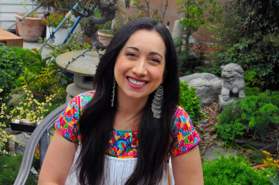 Spanish+Professor+Argelia+Andrade%2C+sits+smiling+in+her+backyard%2C+located+in+North+Torrance+on+Saturday%2C+April+24.+Argelia+is+wearing+a+Huipil%2C+which+is+a+traditional+garment+usually+worn+by+indegiounes+women+in+central+Mexico+to+Central+America.+%28Walter+Jay+Jr%2F+The+Union%29