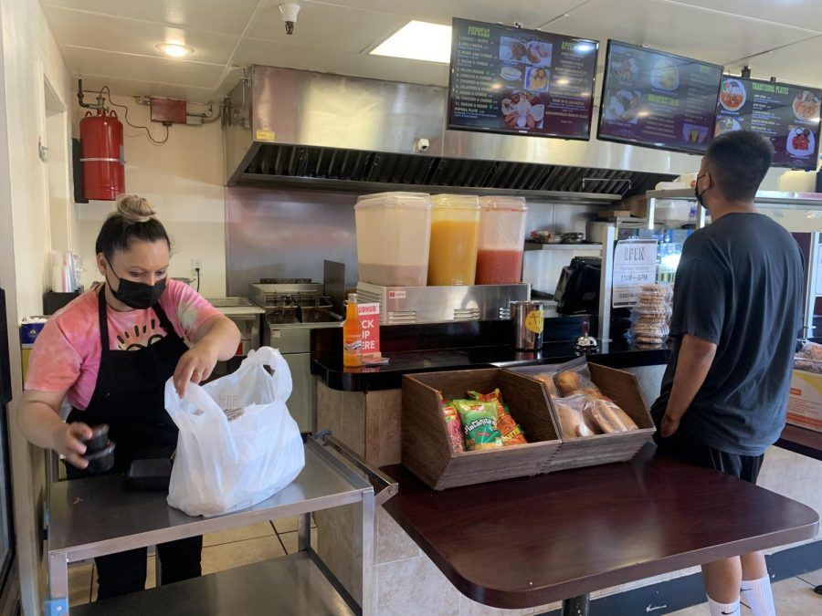 A customer waits to order at Pupusatown, located across the street from El Camino College. (Photo by Molly Cochran/ Warrior Life)