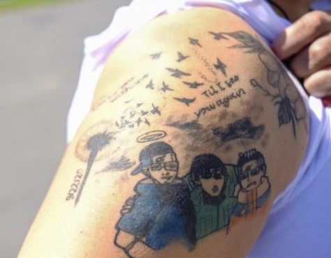 """Shortly after Juan Carlos Hernandez&squot;s disappearance on Tuesday, Sept. 22, 2020, his mother, Yajaira Hernandez got a tattoo on her right shoulder of a dandelion with its seeds blowing into the wind that turn into hummingbirds. A couple of months ago, Yajaira Hernandez said she got the anime like portraits of her three sons tattooed next to it. """"The dandelion flower means resilience to me, pure and innocent. Which is how I viewed my son. I got it hoping that I would be reunited again with Juan one day, whether it be here or in heaven,"""" Hernandez said. """"The color one is a picture of my three sons in anime form. Juan loved Naruto growing up and &squot;till last year he still watched it. So getting these tattoos I feel my son closer to me and will carry them with me &squot;till my last breath."""" Photo by Jose Tobar/The Union"""