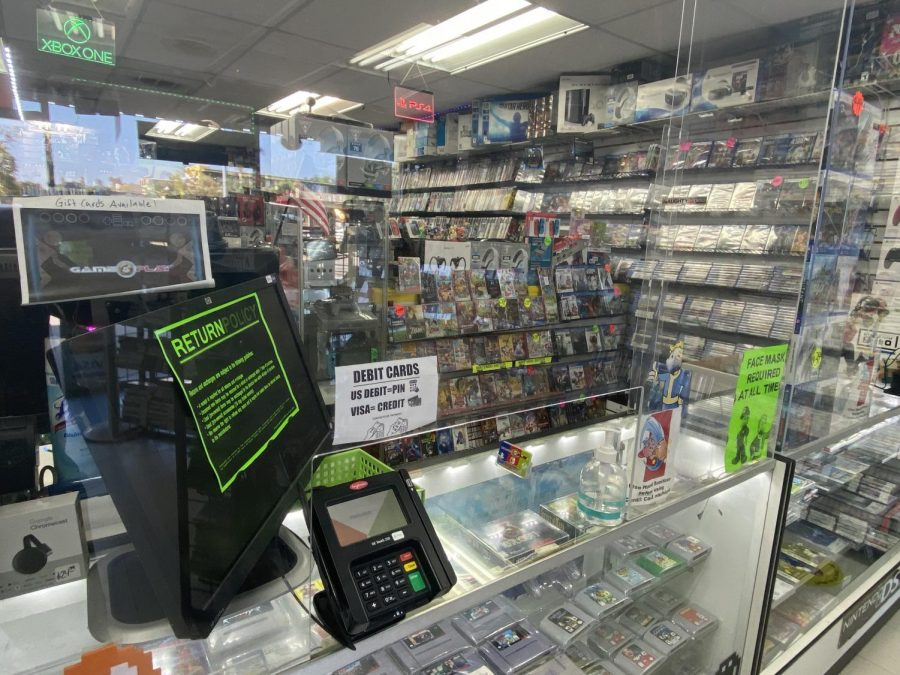 """Gameplay, a video game store in Los Angeles, is sectioned off with plexiglass to keep both their customers and employees safe from Covid-19. """"Because of COVID, our owners had to get these plexiglass shields installed and we sectioned off the store in half, that way it's much easier to clean and manage,"""" Andrew Sandoval, a cashier at Gameplay said. Photo by Khoury Williams Photo credit: Khoury Williams"""