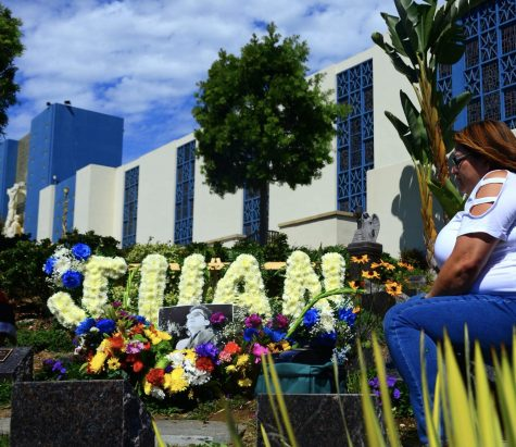 A year ago on Sept. 22, 2020, 21-year-old El Camino College student, Juan Carlos Hernandez-better known to those closest to him as Cookie-was murdered sometime after his night shift inside a Los Angeles dispensary where he worked. His body was later discovered buried in a shallow grave in a remote area of the Mojave Desert on Nov. 15, 2020-about a month later from what would have been his 22nd birthday, according to a District Attorneys press release. On Wednesday, Sept. 22, 2021, family and friends reunited during a Memorial Mass to honor his memory at the Saint Vincent de Paul Parish in Los Angeles. As part of the memorial, the Hernandez family would travel to the dispensary site where they would place a sidewalk memorial and make a final stop at the Holy Cross Catholic Cemetery to place flowers and decorate the tombstone where a portion of Hernandezs ashes lie. Photo by Jose Tobar/The Union Photo credit: Jose Tobar
