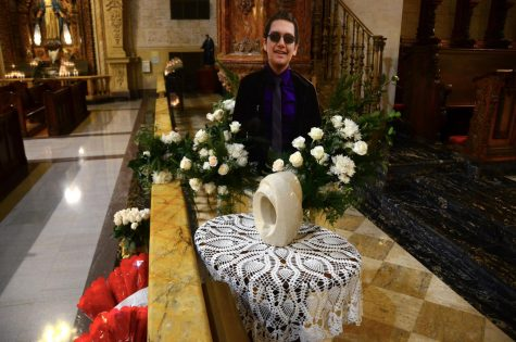 An altar for Juan Carlos Hernandez adorns the entrance to the church pulpit at the Saint Vincent de Paul Parish in Los Angeles on Wednesday, Sept. 22, 2021.