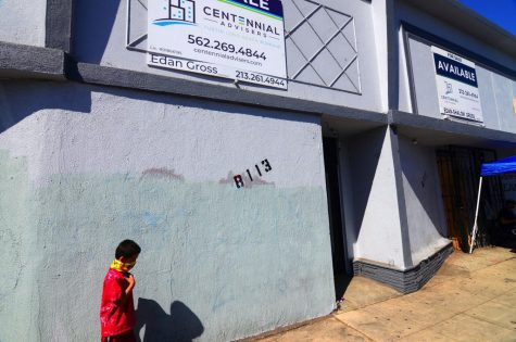Six-year-old Erick Melendez, wanders outside the dispensary's storefront where his cousin, Juan Carlos Hernandez was murdered on Sept. 22, 2020. Melendez was very close to Juan and two would spend time together almost everyday, Yajaira Hernandez said. Hernandez's family friends will place a sidewalk memorial outside its wall. Photo by Jose Tobar/The Union