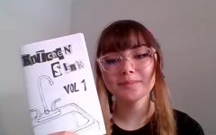 Emma Schlossman holding volume one of the Kitchen Sink Zine, a zine she and Misha Hashemi published. [This] zine has a lot to do with identity, personal experiences, and self-expression, Schlossman says. Photo taken on September 15. Safia Ahmed/The Union